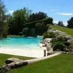 The pool boasts a white-sand beach