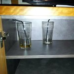 dirty glasses under tv cabinet