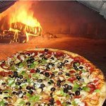 Our delicious firewood cooked Pizza