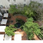 Looking down into the hotel courtyard from our room