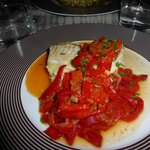 White fish with mashed potatoes, chorizo and red peppers