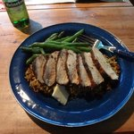 One of the dinner served: herb-crusted chicken and wild rice