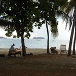 Massage on the beach next to our chairs - a stones throw from the open air dining area