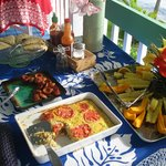 Apricot scones, Portuguese sausage, egg casserole, and papayas, bananas, avocadoes, and pineappl