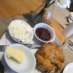 Homemade scone served with butter, homemade preserves and fresh cream