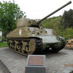 The sherman tank in font of the gate of the castle