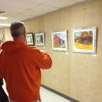 Steve Witt enjoys the art.