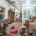 The Conservatory with dining area and lovely place to have a dink from ther bar