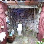 Bathroom with stone walls