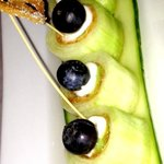 Cucumber stuffed with cream cheese and tofu, topped with a blueberry