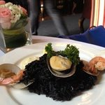 Delicious black paella for brunch