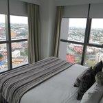 bedroom 2 walls floor to ceiling windows