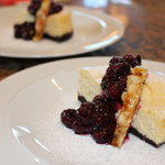 NY style cheesecake blueberry compote and macadamia praline
