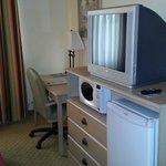 TV and microwave with mini-fridge.