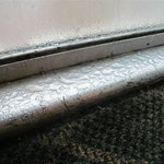 Metal on outside door frame
