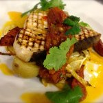 Grilled swordfish steak on crushed new potatoes, fennel & orange served with chorizo topped with