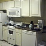 A small but well stocked kitchen in one bedroom condo.