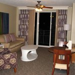 One bedroom condo has a spacious living room with small dining area.