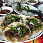 Steak tacos with onions & cilantro