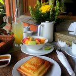 Breakfast - Banana Jaffle, fruit bowl, fresh juice & coffee/tea