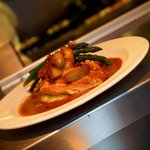 Pan seared local chicken breast, confit fingerling potatoes, leek fondue, asparagus, pancetta