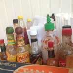 Half the selection of hot sauces. More at the counter!