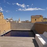 Rooftop pool and sun area