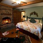 Oldest room in the inn wide pine plank floors w/wood burning fireplace