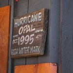 Sign on Red Bar patio showing water level during hurricane Opal.