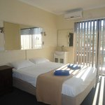 Standard Room. All have balconies, queen bed, reverse cycle airconditioning.