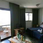 Два окна с выходами на длинный балкон