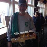 Brad delivering a beer sampler