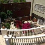Garden patio below pool area