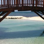 bridge from hotel property to bigger beach