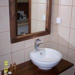bathroom has modern fixtures and adequate counter space