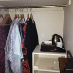 A nice large hanging space to clothes stored outside of the main room