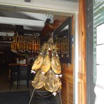 Hams at the entrance of Cerveceria Costa Gallega