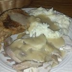 Fresh roasted turkey, stuffing, mashed potatoes, and gravy.  Also they served warm rolls and sal