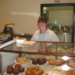 Working the pastry counter.