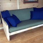 Futon couch in living room area