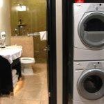 washer/dryer in closet next to 1/2 bath
