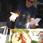 Restaurant's Owner Showing a Lobster