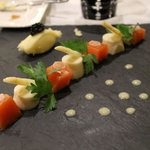Salmon (raw) with white asparagus appetizer, dots of Vinegrette