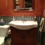 Super cute bathroom with corrugated tin siding