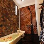 spacious bathroom with rain shower
