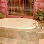 Shared bathroom has a soaker tub