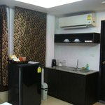 deluxe room with sink and fridge