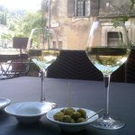 Great place for wine and it comes with olives, bread and olive paste