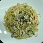Shrimp pasta with pancetta, mushrooms and garlic.