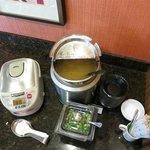 Japanese breakfast: rice, miso soup, dried seaweed, green onion